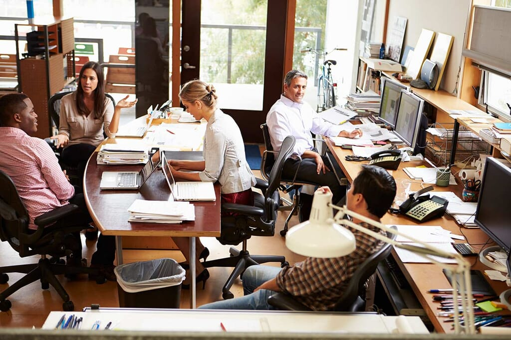 interior-of-busy-architects-office-with-staff