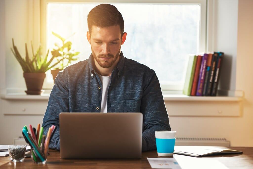 Entrepreneur working at a laptop computer